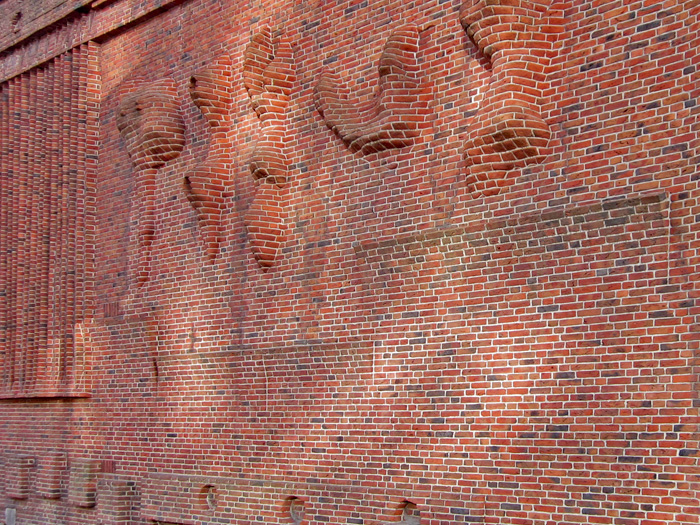 Exposed brick wall by Henry Moore